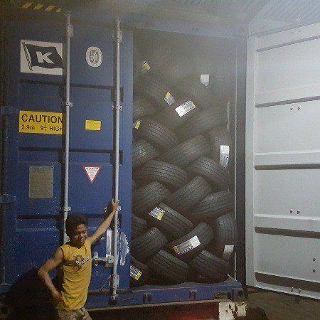 Loading container with GT Radial and Michelin tires